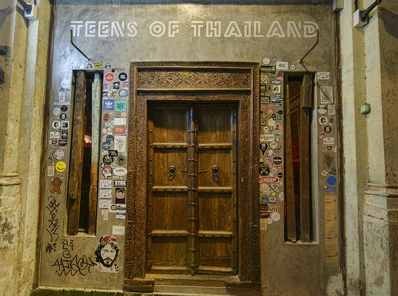 old wooden entrance door at Teens of Thailand bar
