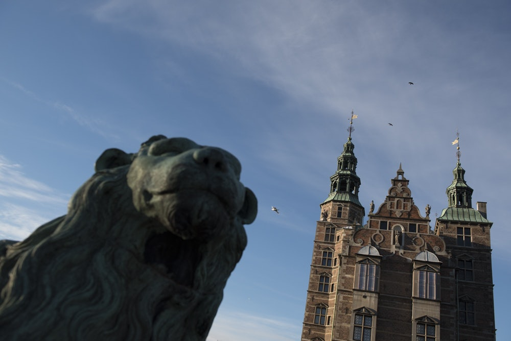 statue of a lion in front of the Rosenborg Castle in Copenhagen