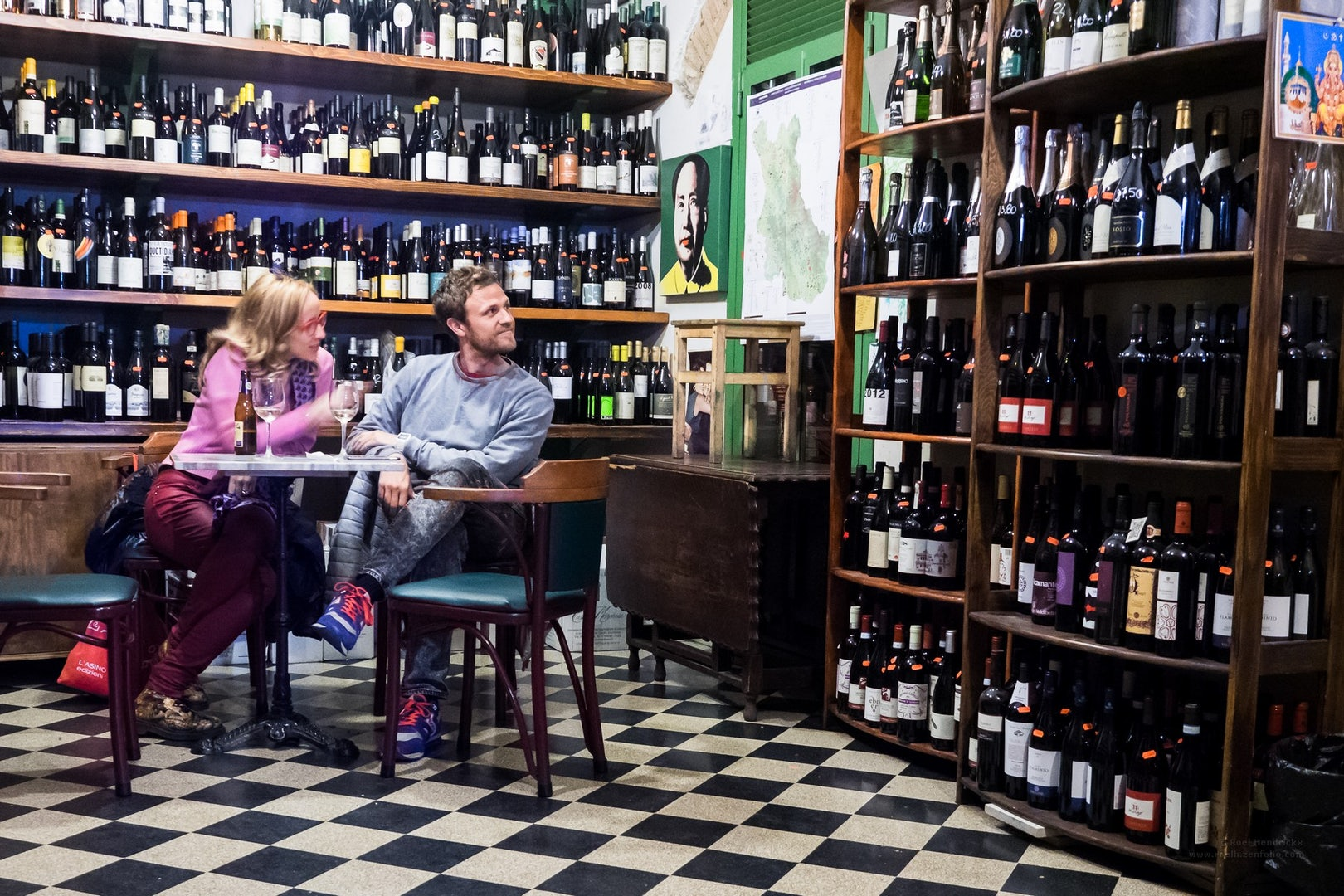 a couple sitting down at Il Vinaeitto wine bar
