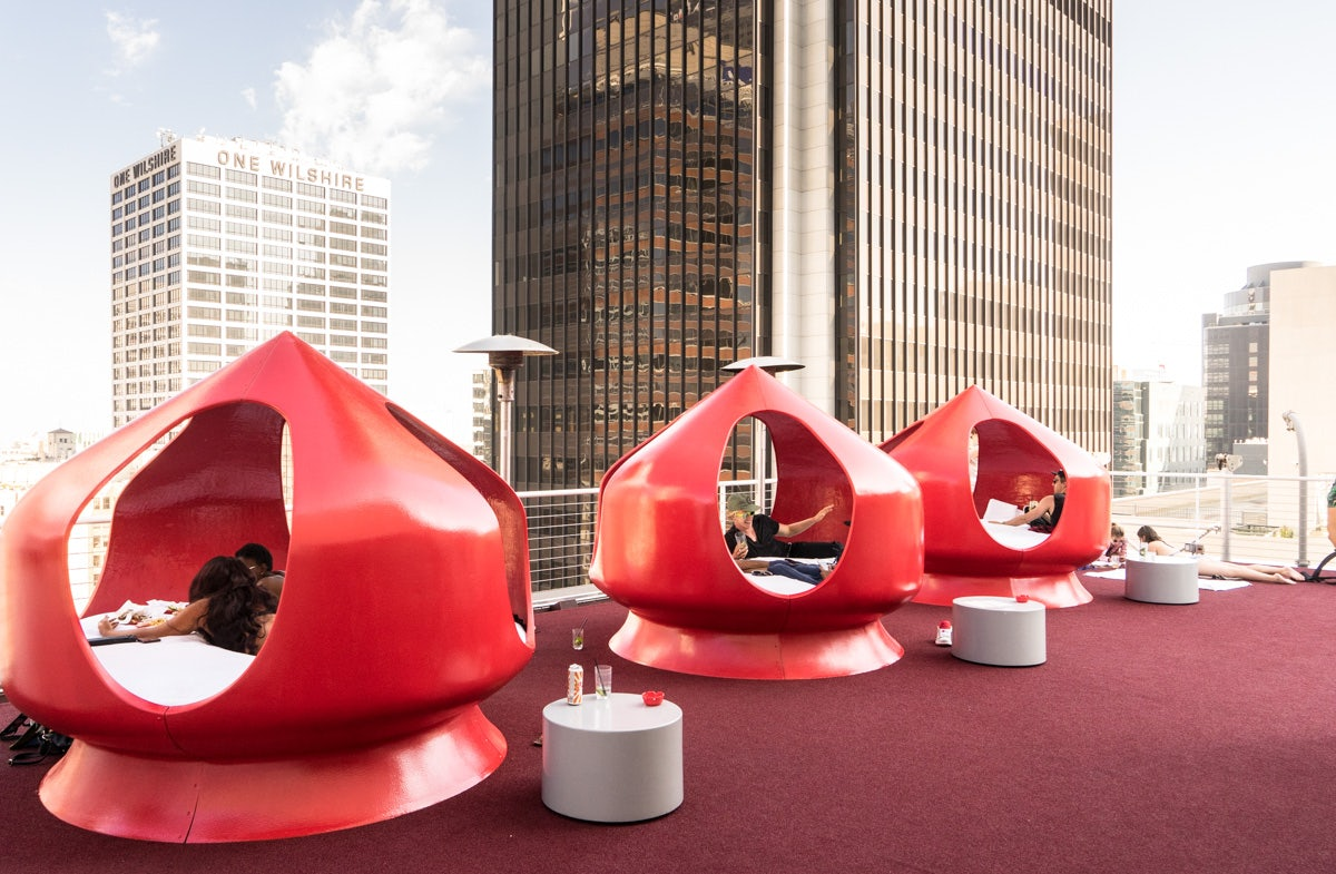 red lounging pods at the Rooftop of the Standard Hotel LA