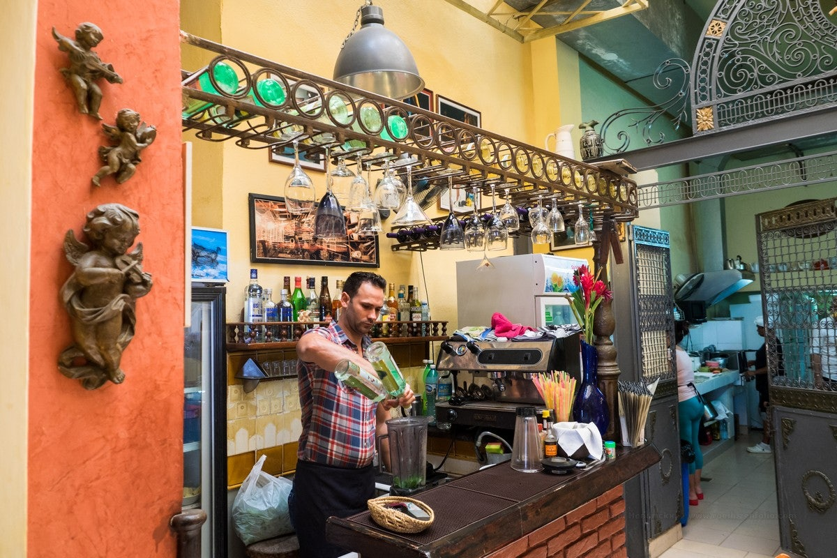 a man making cocktails at Dona Eutimia Havana