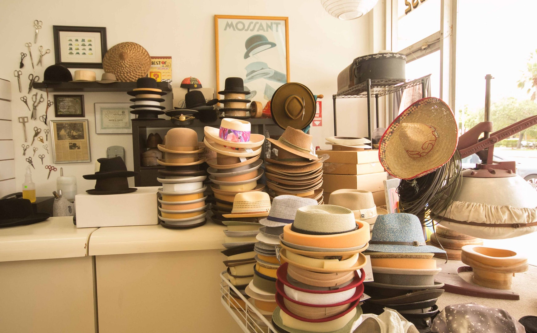 many kinds of fedoras on a pile