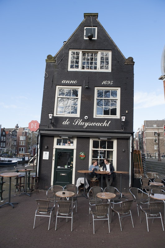 a black crooked house the Sluyswacht in Amsterdam