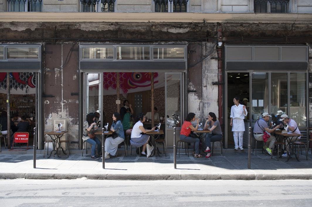 people sitting outside at Kunitoraya