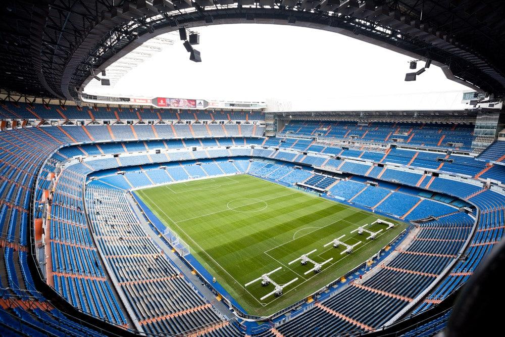 an empty Estadio Santiago Bernabeu in Madrid
