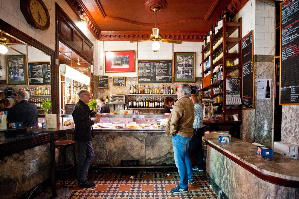 two men ordering food at Stop bar Madrid