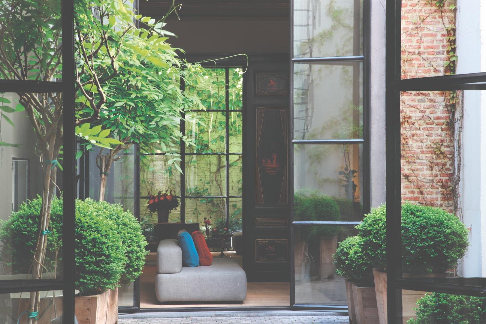 garden and interior of Hotel Julien Antwerp