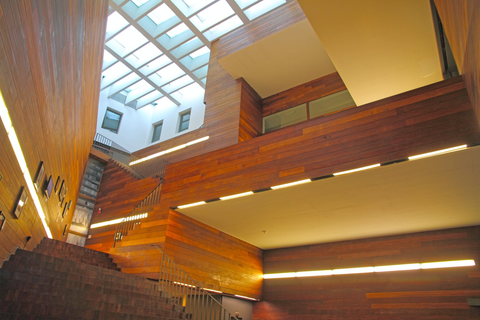 interior with wooden and glass design at the Antwerp museum of fashion