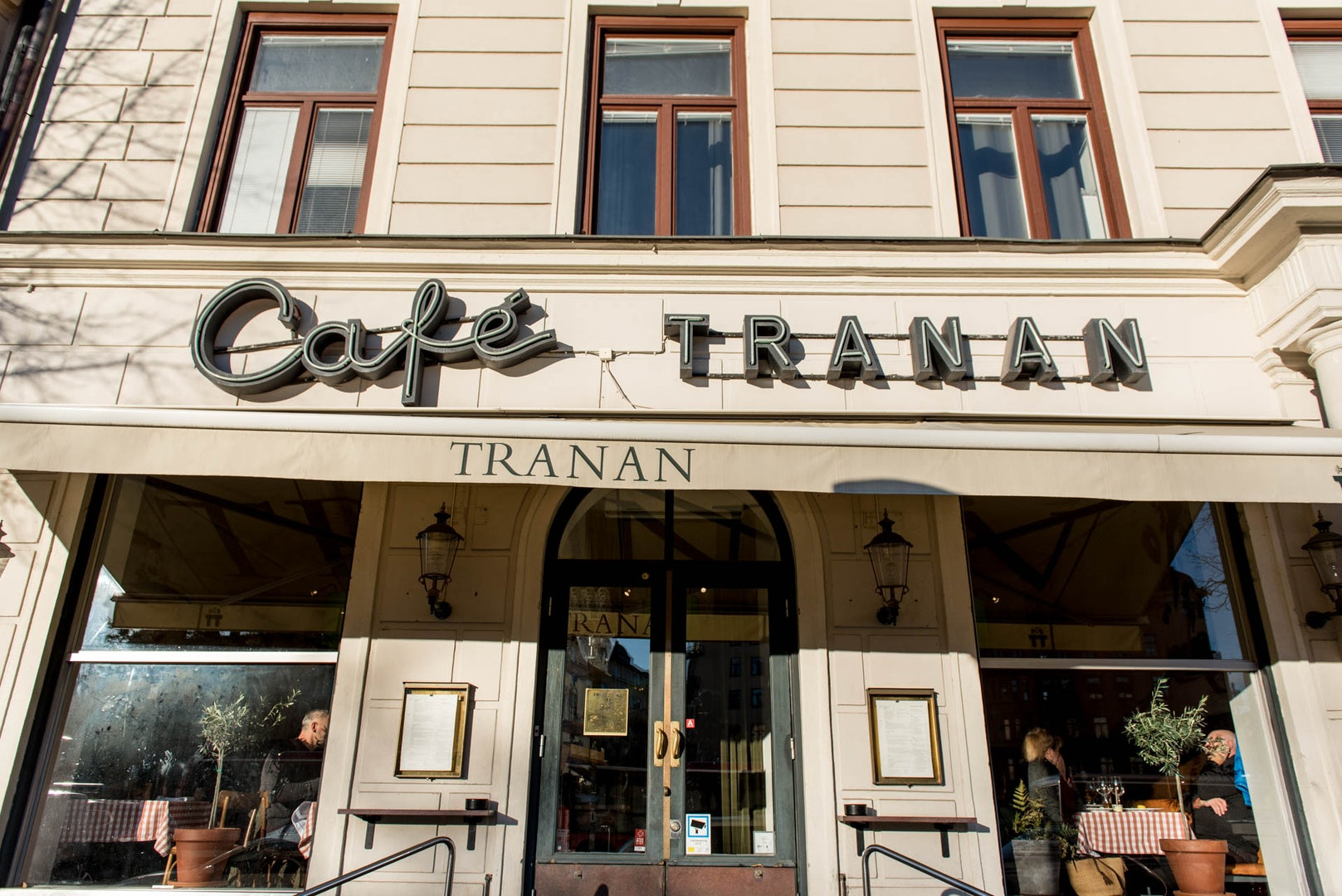 name sign at the front of Cafe Tranan