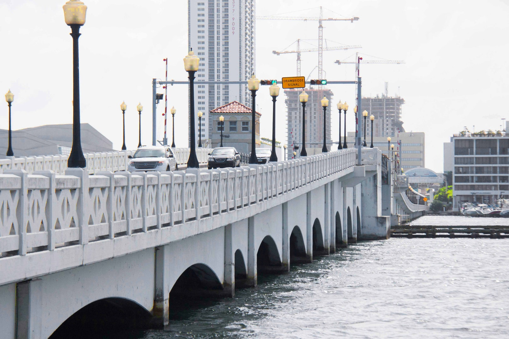 cars driving over the venetian causeway in Miami