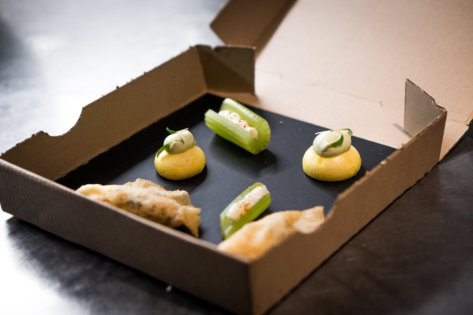 culinary snacks in a carton box from Cookies Cream