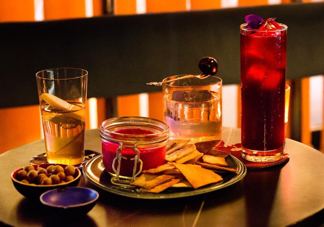 three cocktails and nachos with dipping sauce