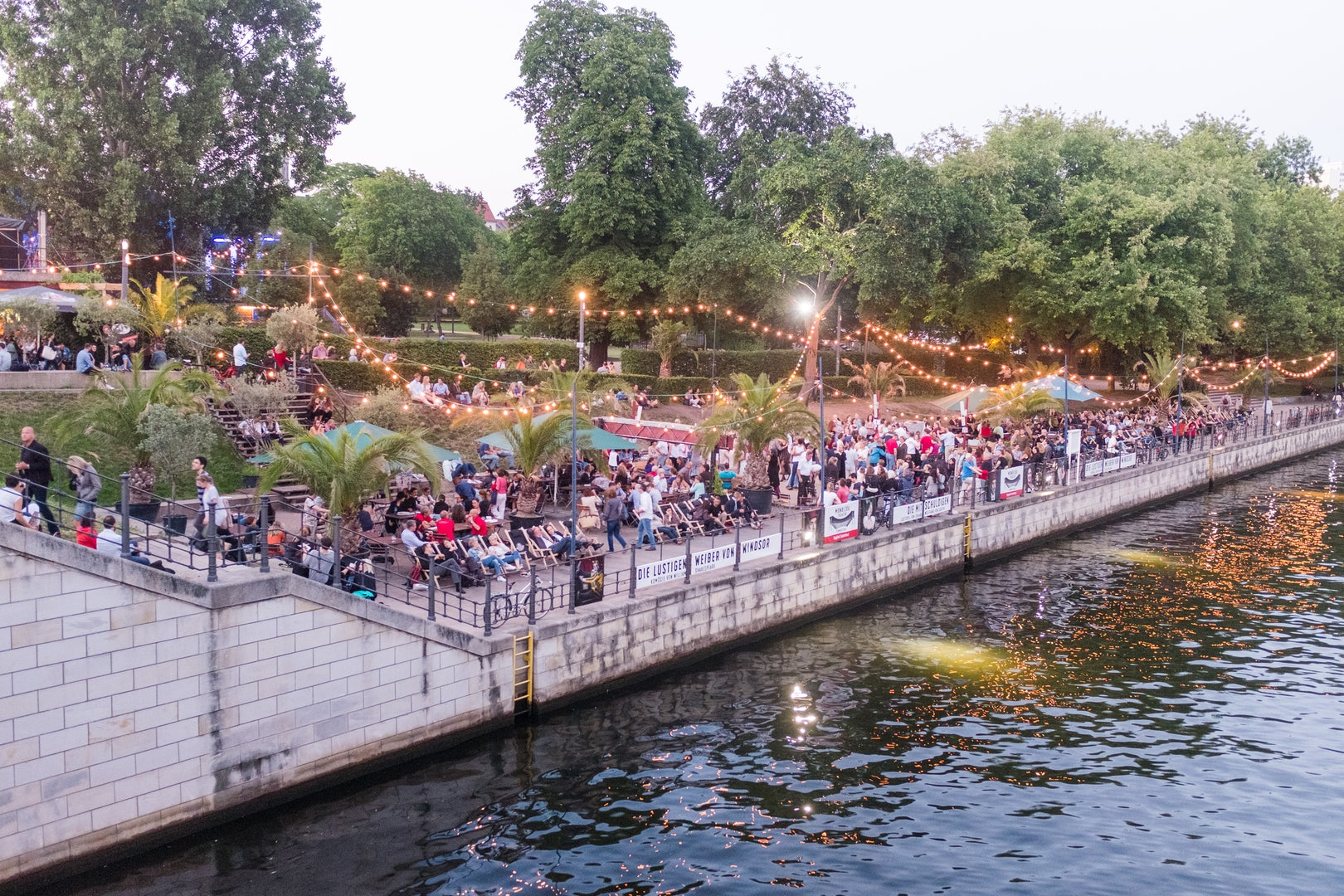 people by the water at Strandbar Mitte