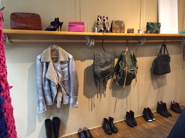 a sliver jacket and accessories displayed at Das Neues Schwarz Vienna