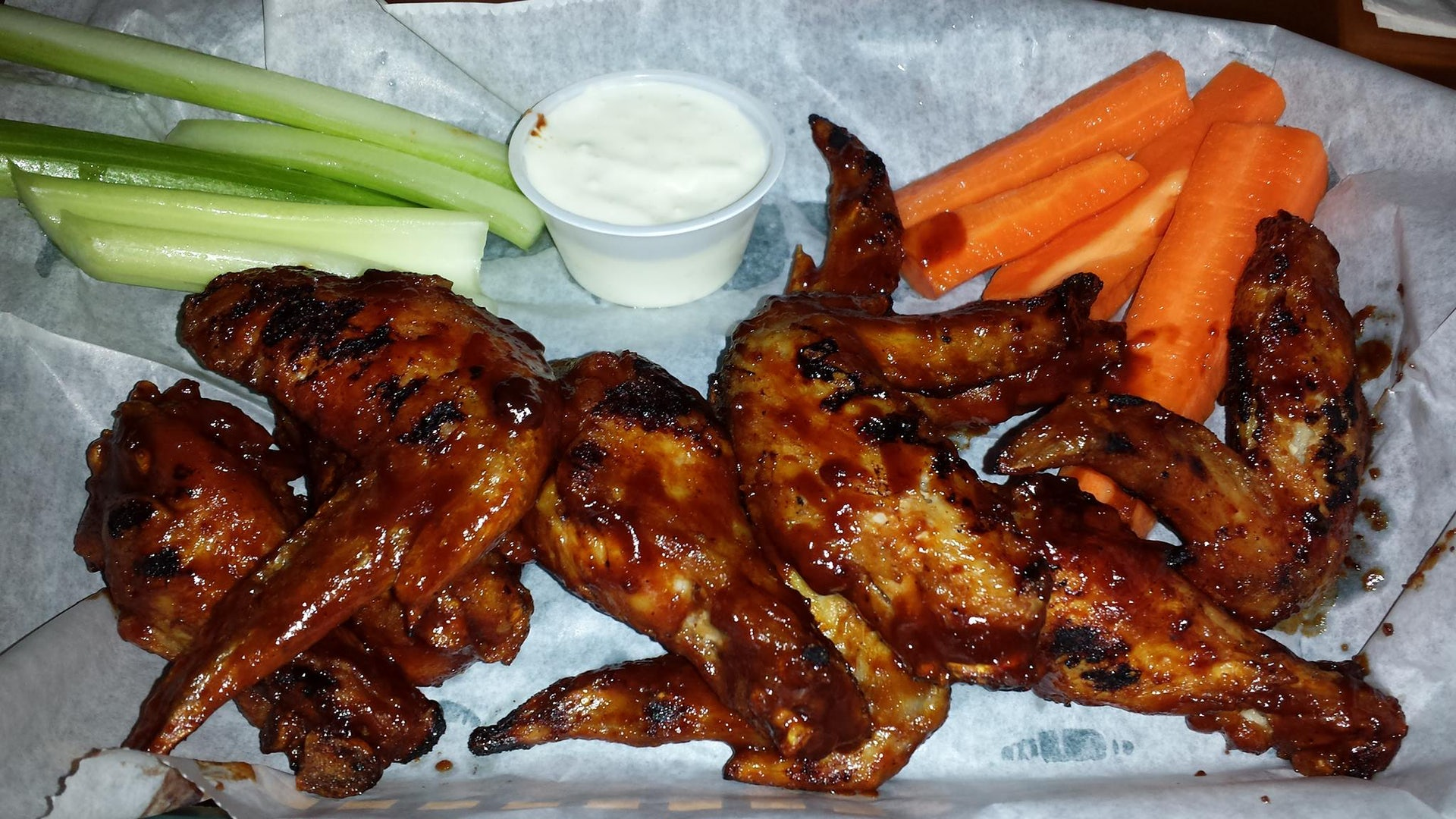 grilled chicken wings and vegetables at Corbett's Sports Bar & Grill
