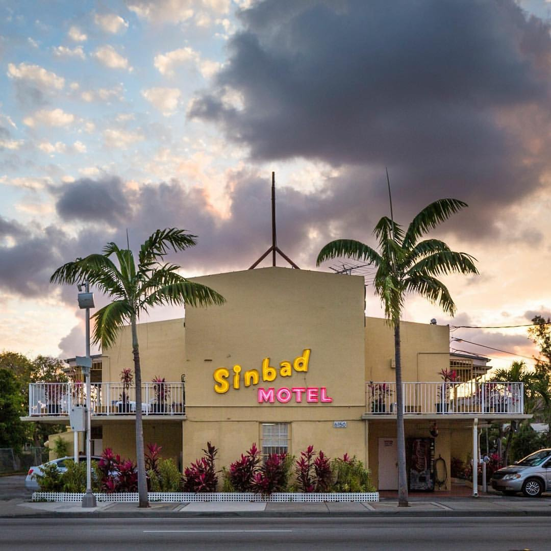 the Sinbad Motel against a sunset sky