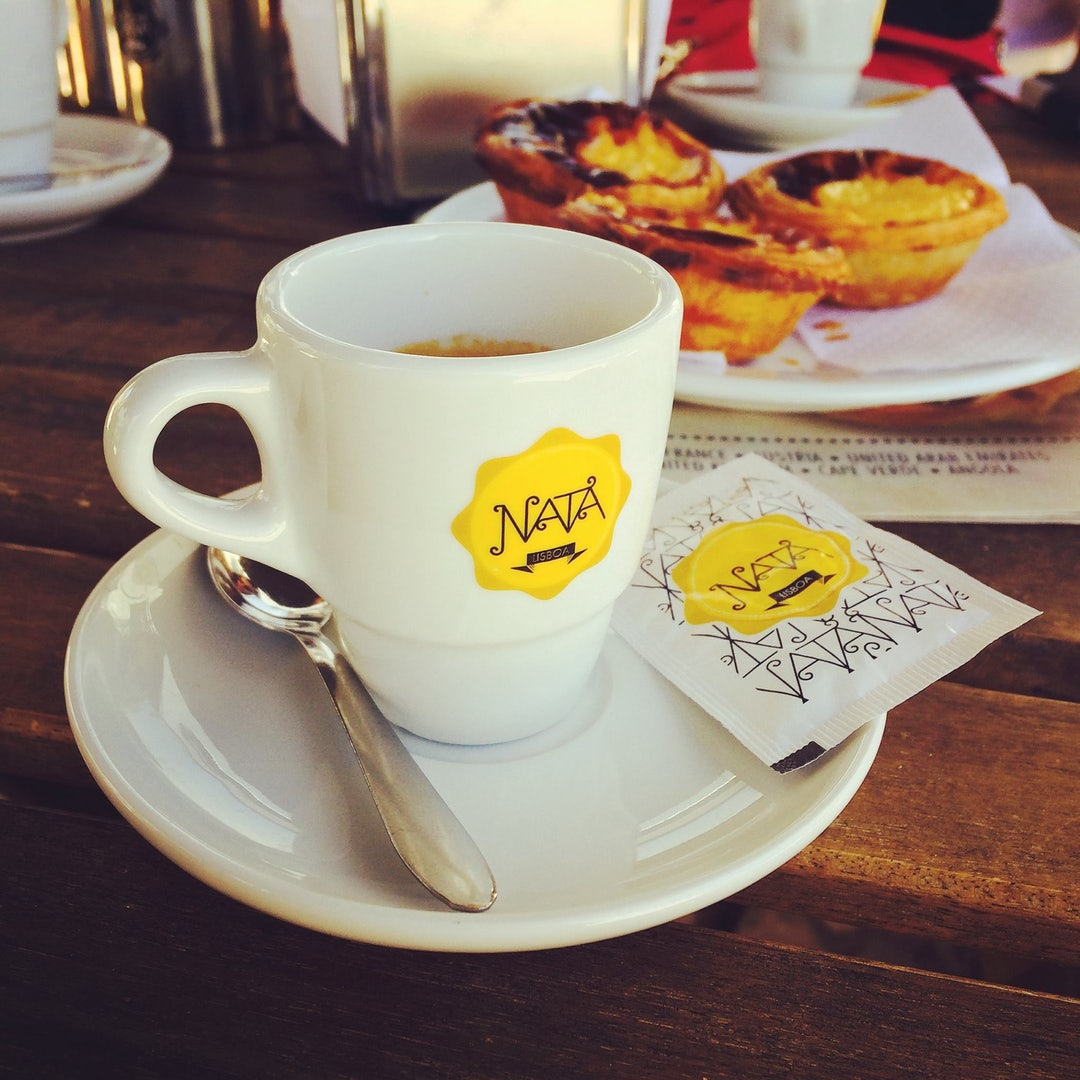 a cup of coffee and pasteis de nata from Nata Lisboa