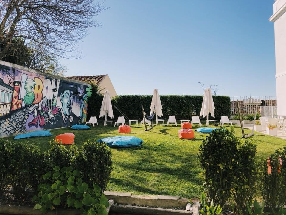 garden with bean bags and mural painting at the Lisb'on Hostel