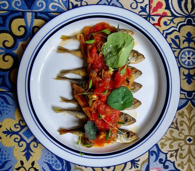 a dish with dried fish and tomato sauce from Casa de Pasto
