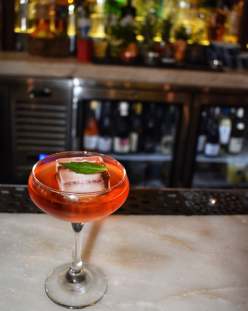 a red coloured cocktail at Kyu bar Miami