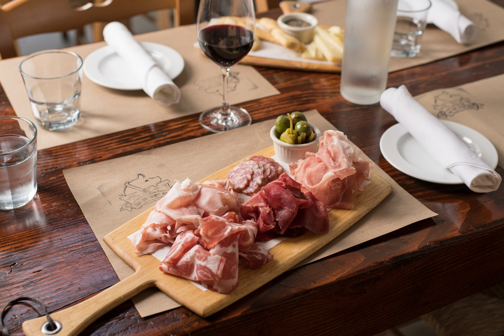 plate of cold cuts and olive and wine at the Salumeria 104