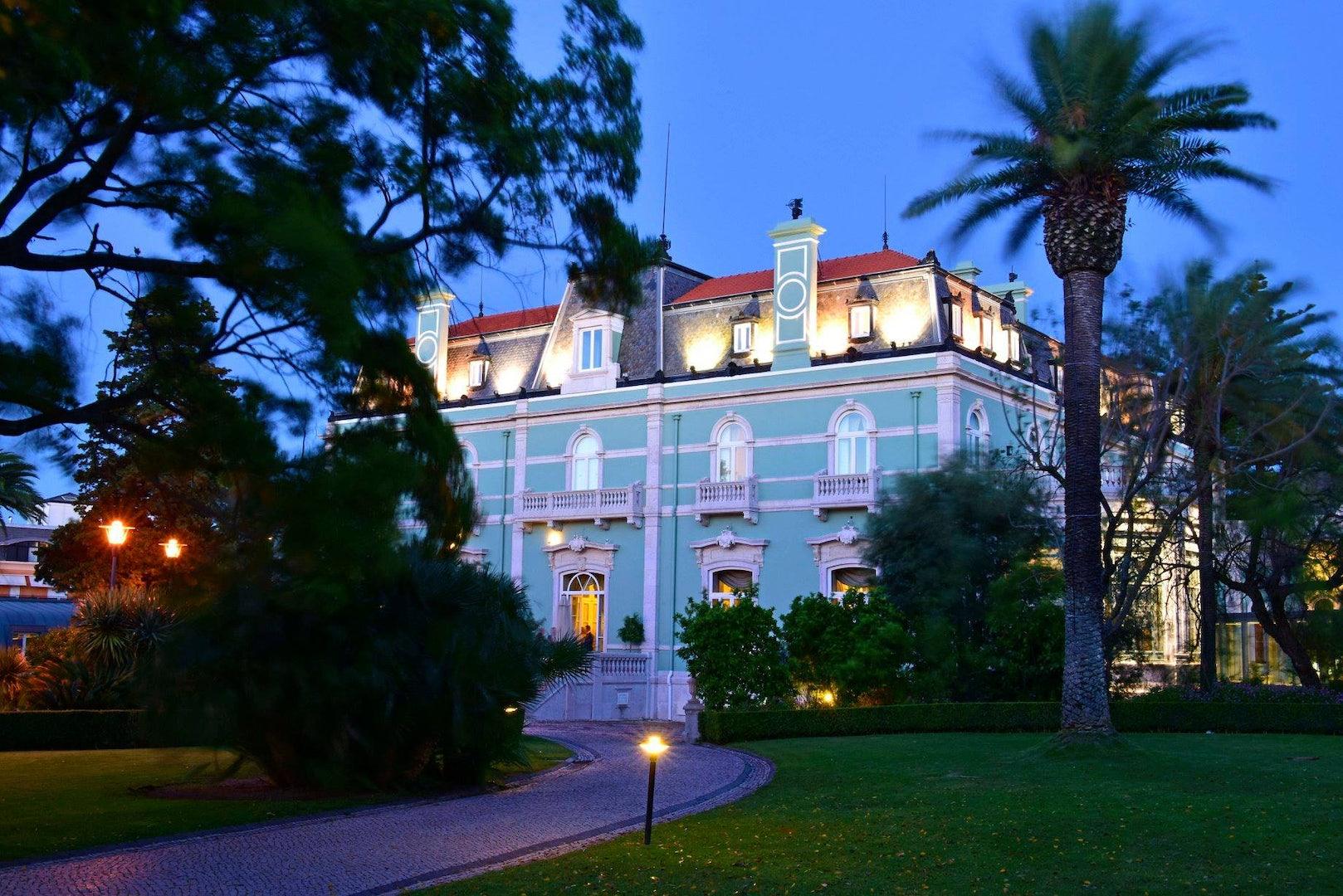 garden and bright blue exterior of the Pestana Palace