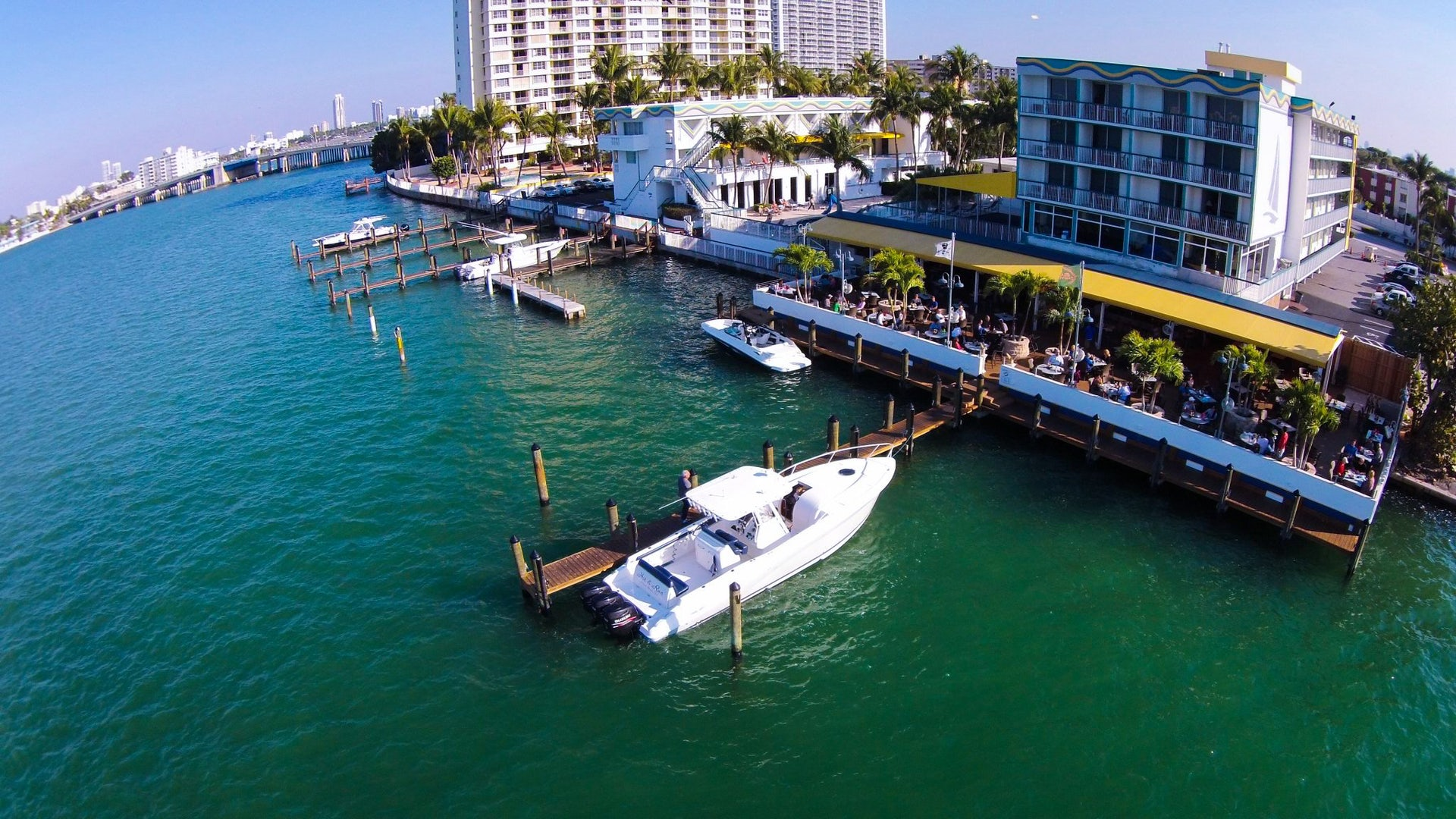 a boat docked at Shuckers Waterfront Grill