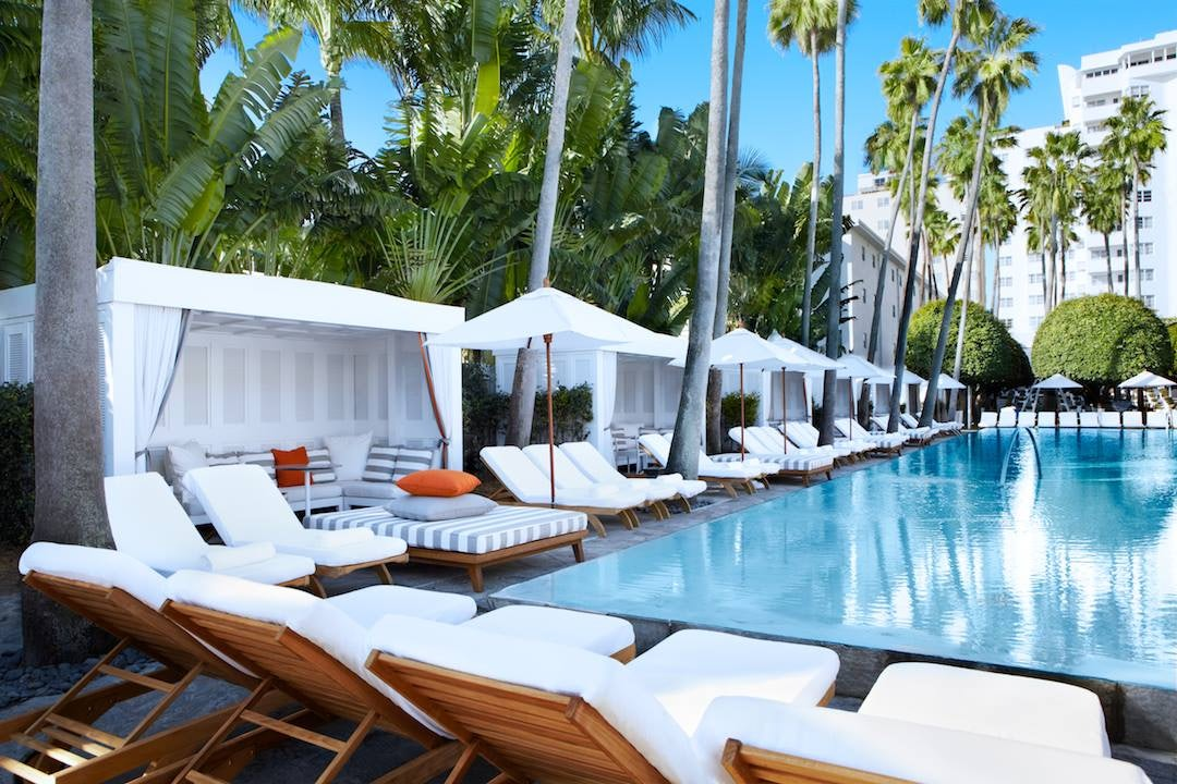 swimming pool and white lounge chairs at the Delano South Beach