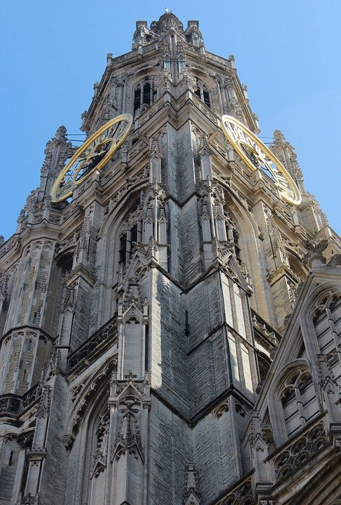 ground view of the Antwerp Cathedral tower