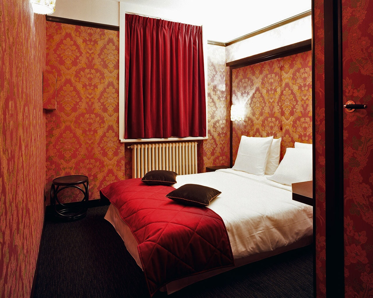 red room at Le Berger hotel