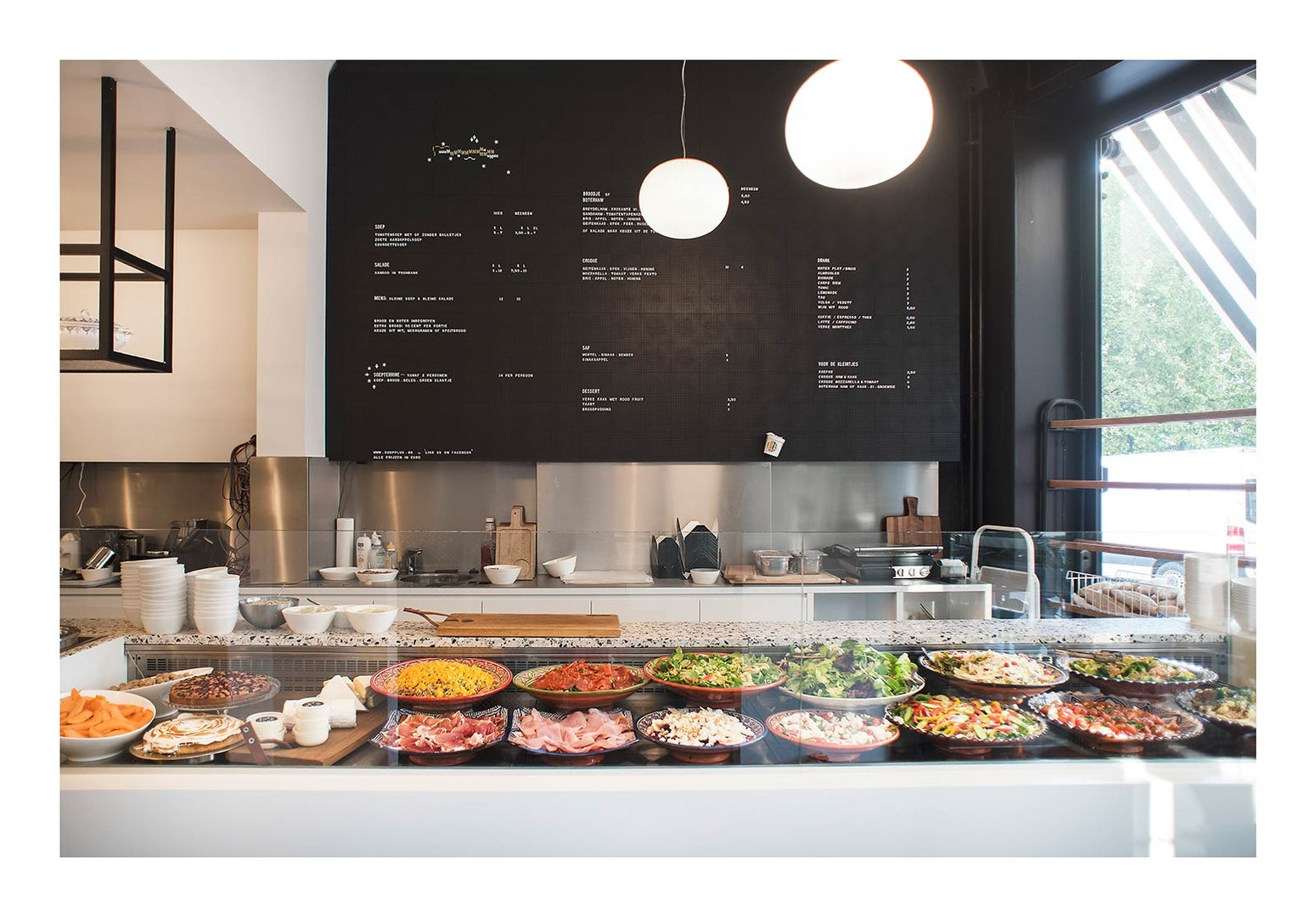 a counter full of salads at Soep+ interior