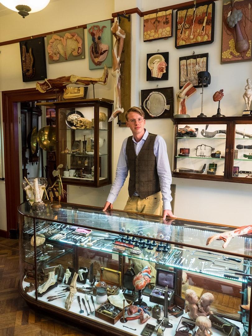 shop owner of Van Leest Antiques in the store