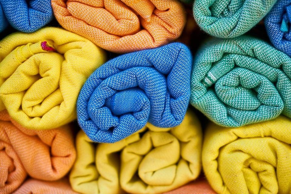 blue, orange, green and yellow textiles