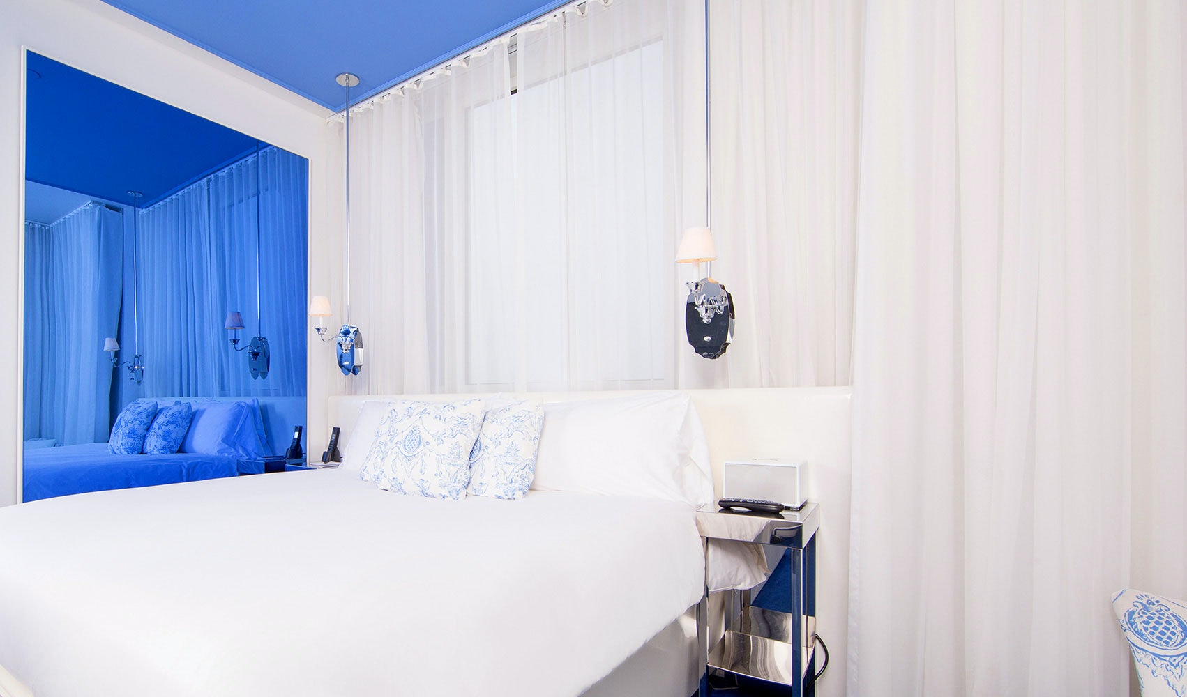 white and blue designed room at Nomo