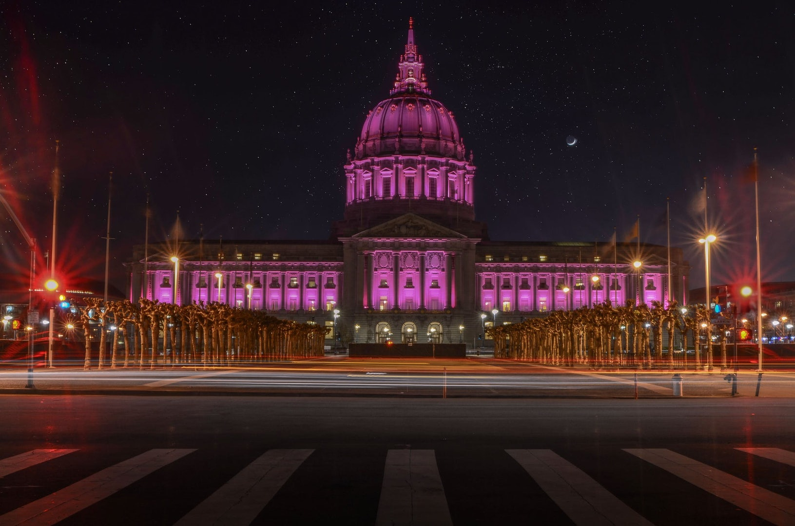 a pink-lighted San Francisco City hall