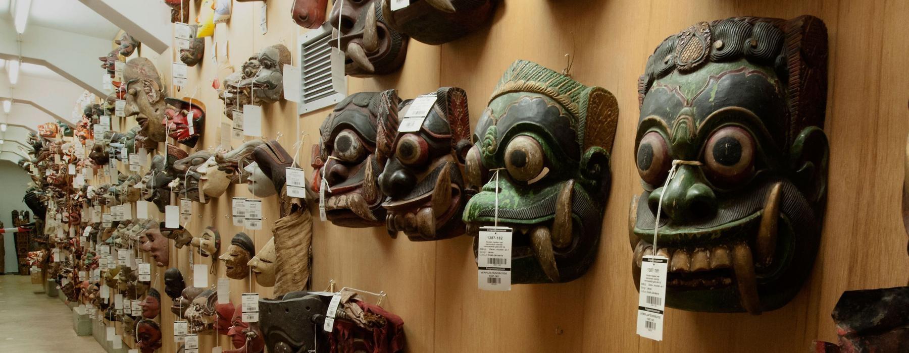 historic masks hanging at Wereldmuseum
