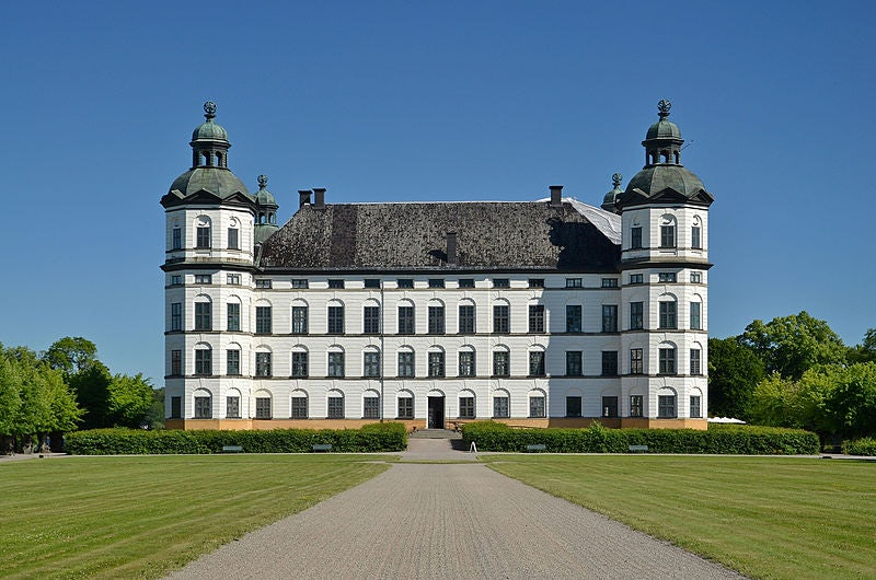 exterior of the Skoklosters Slott and a perfectly mowed lawn