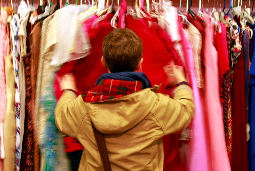 a woman shopping for vintage clothes