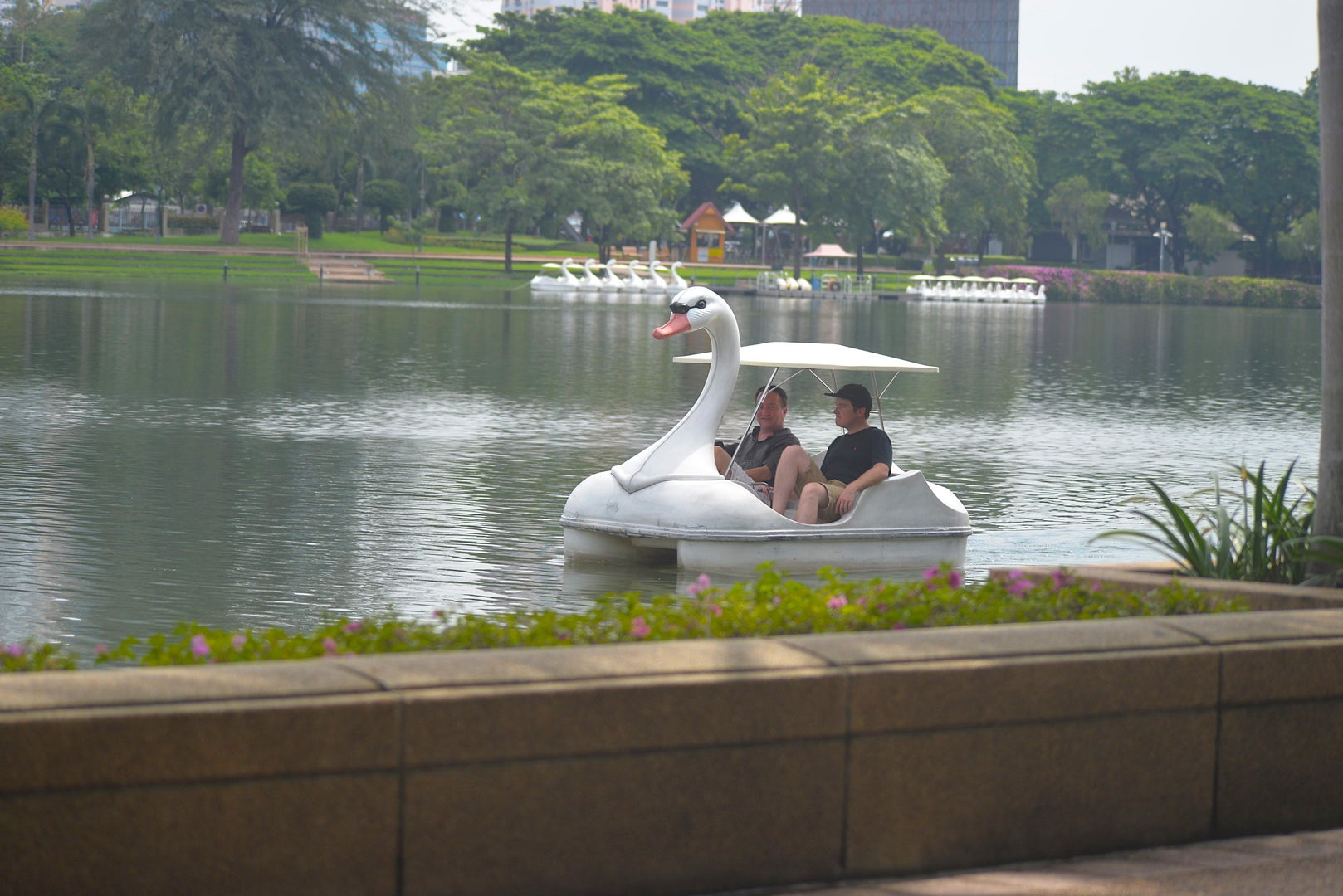people paddling in Benjakitti Park