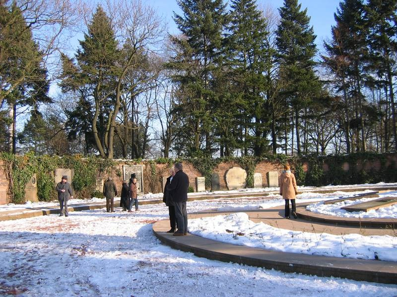 people on a snow white day at Central Cemetery Friedrichsfelde