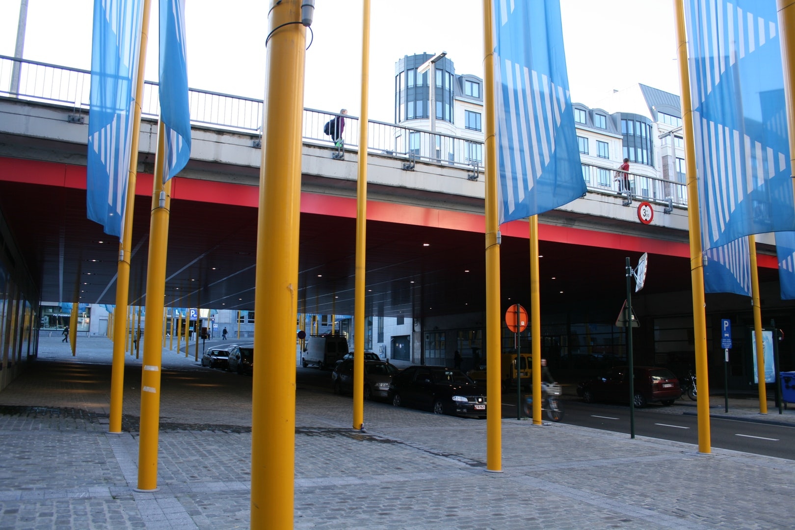 yellow and blue flagpole at Place de la Justice