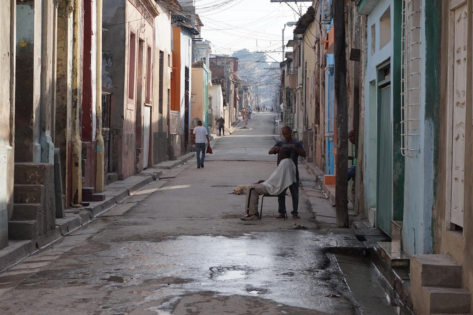 barber on the street in Havana