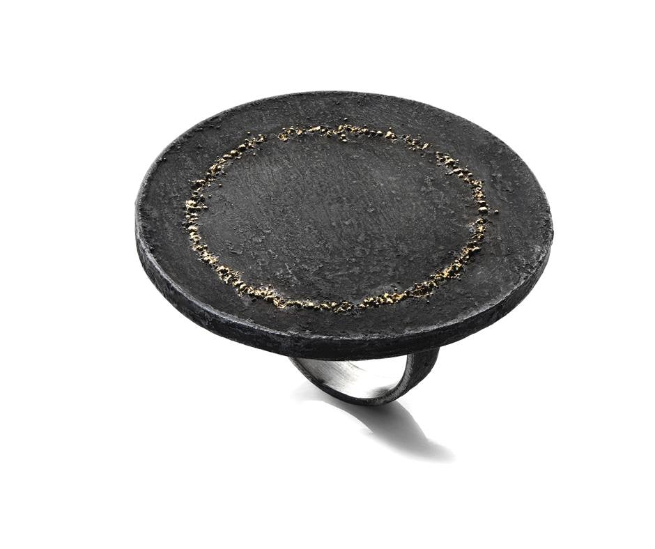 a black ring made of stone from alternatives gallery Rome