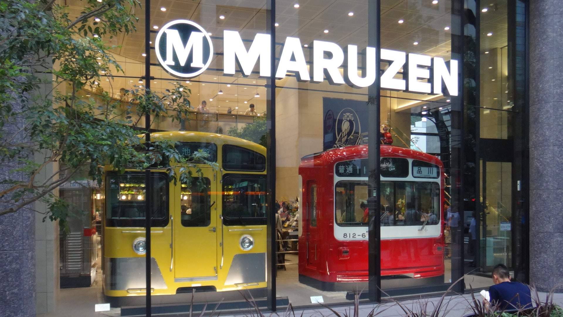 two tram carriages in the window display of Maruzen Ikebukuro