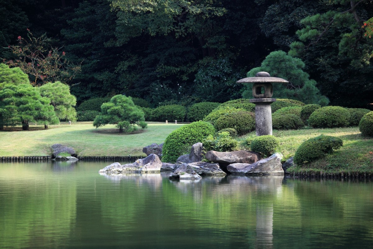 a pond and grass meadows at Rikugien Gardens in Tokyo