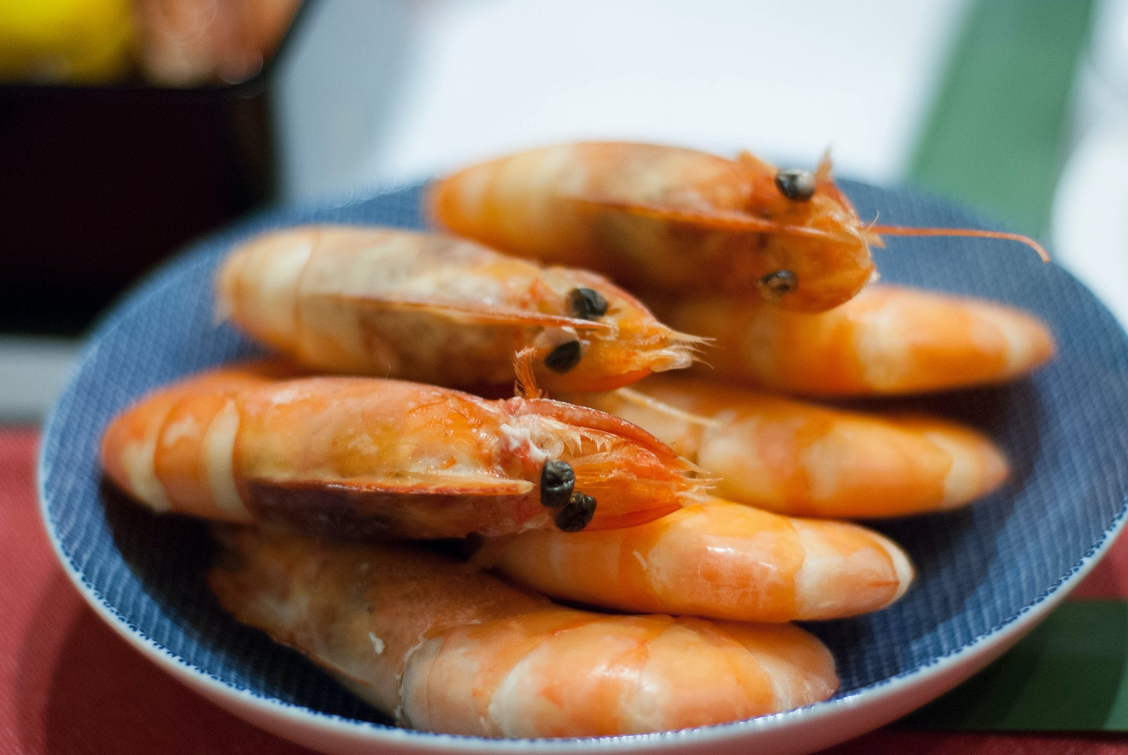 a plate of cooked shrimps