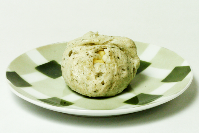 a green coloured bun on a green plate from Mugimaru 2