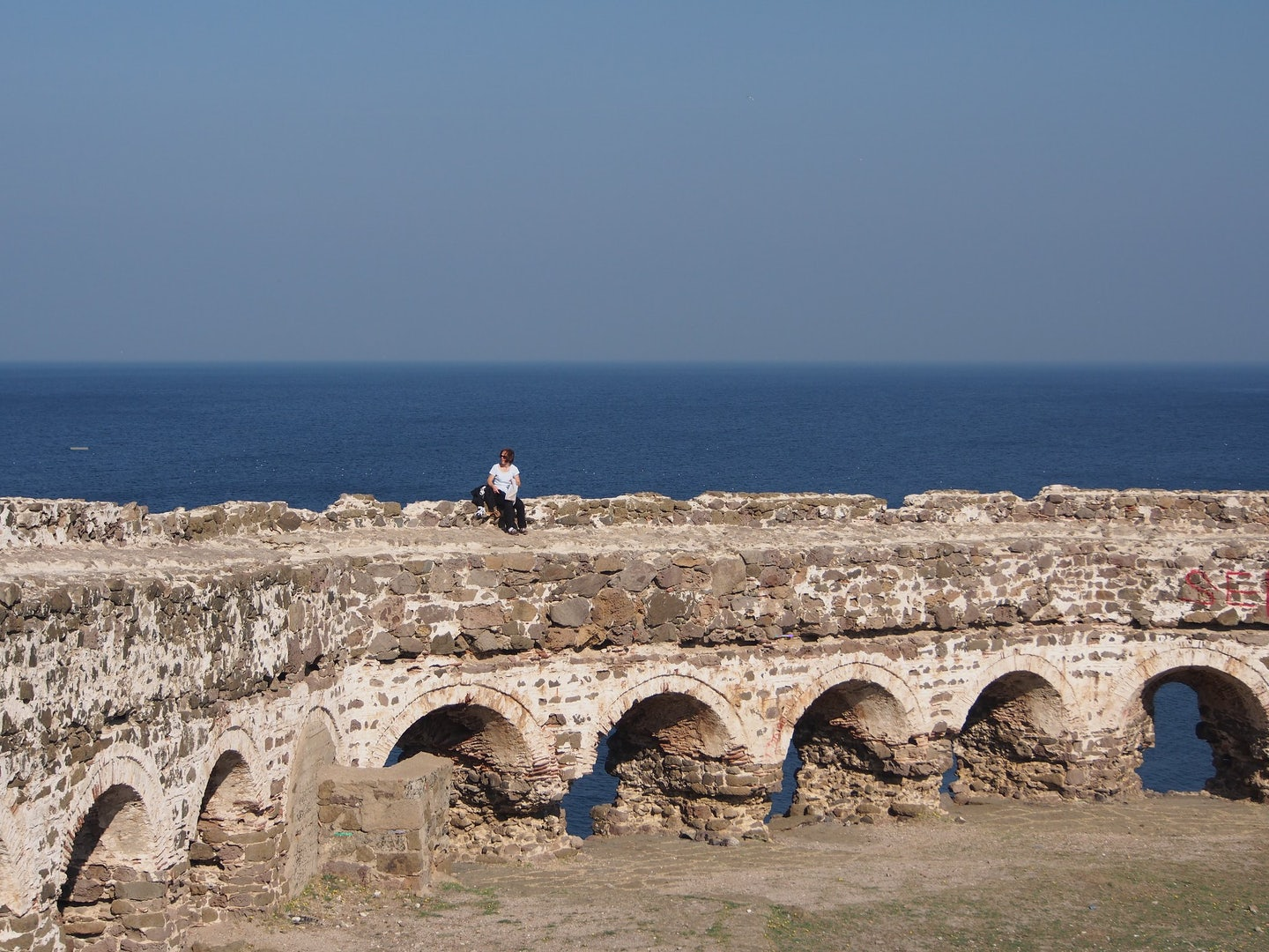 a woman on top of Rumeli Feneri Castle in Istanbul