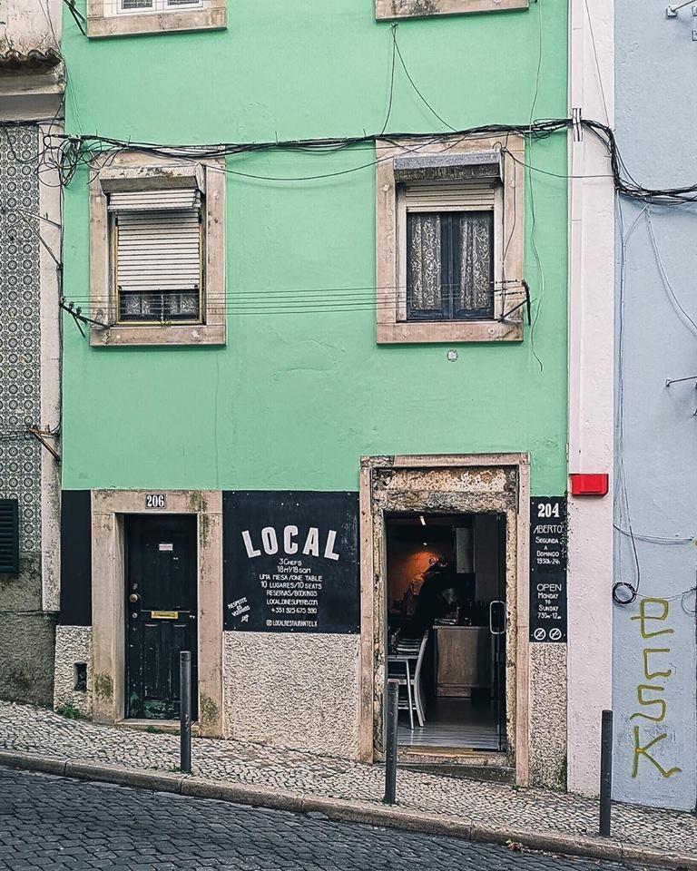 mint green exterior of restaurant Local