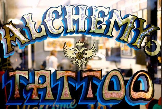 window sign of Alchemy Tattoo LA